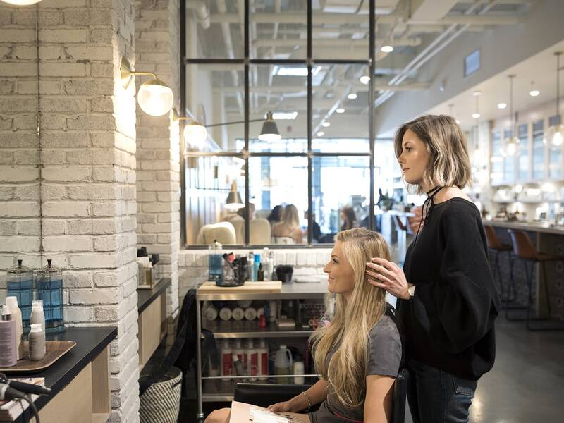 woman having hair done at salon - How Much To Tip Hairdresser At Christmas