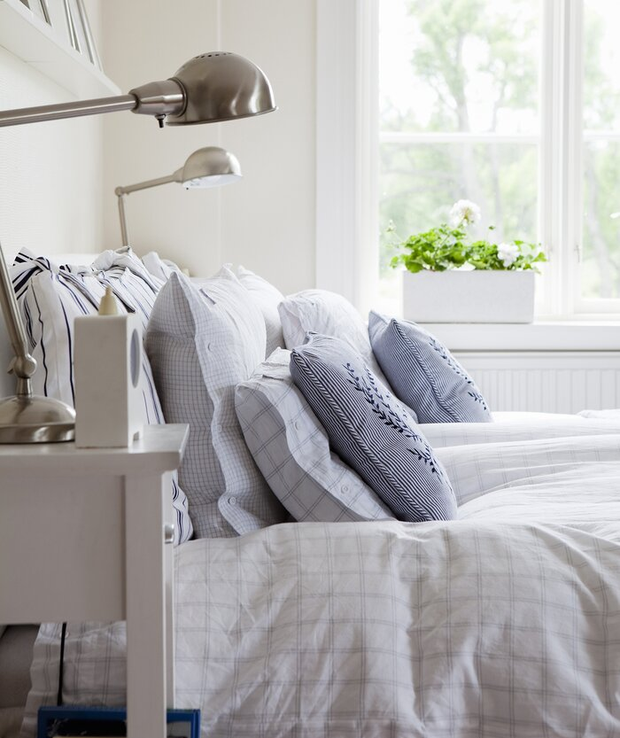 9 small cleaning resolutions that will make a big difference real bedroom with well made bed ccuart Images
