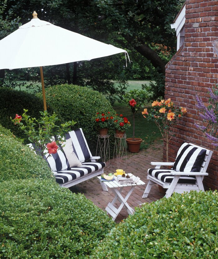 Small Patio Surrounded By Hedges