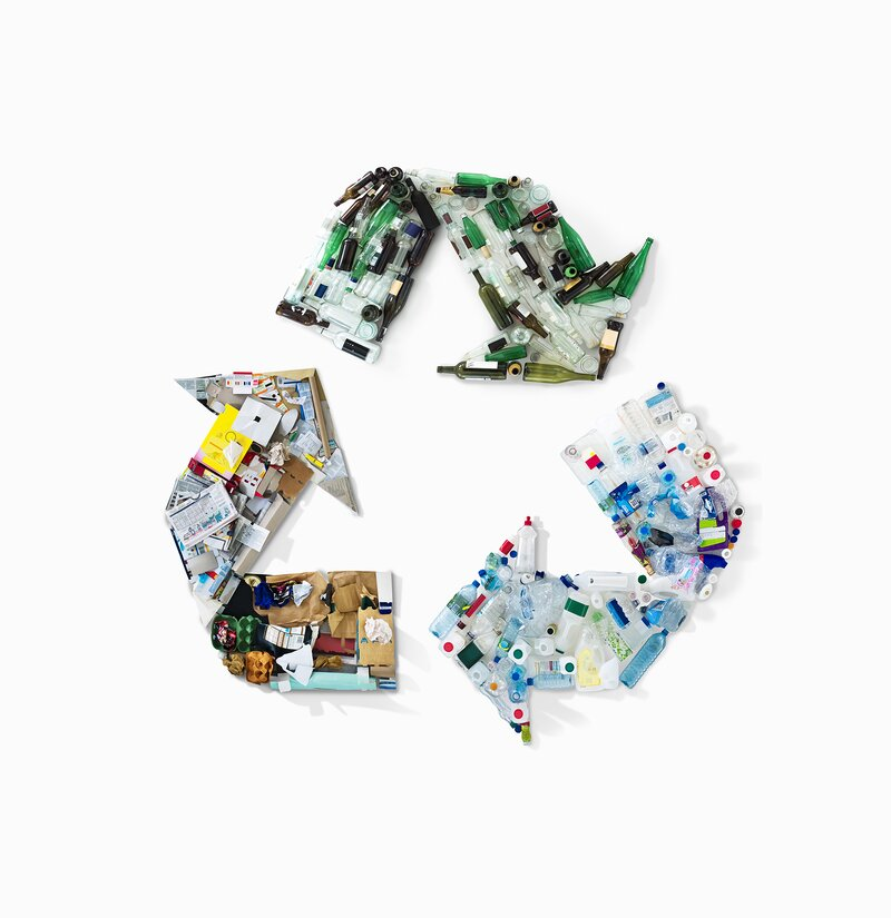 Recycling symbol made of recyclable objects
