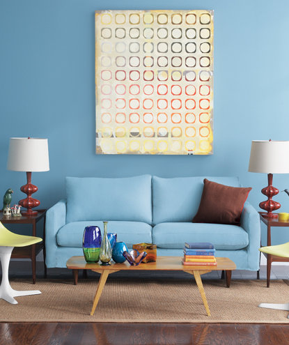 simple living room. blue living room with yellow chairs and sofa simple real