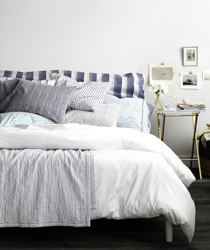 bed with blue and white linens - Decorating Bedroom