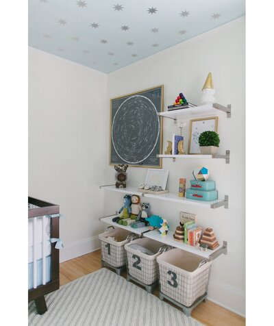 Nursery with basket storage and starry ceiling