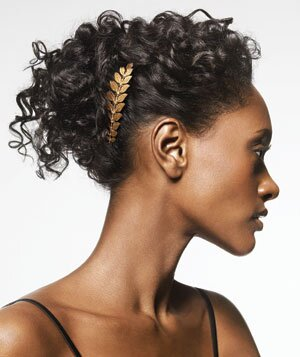 Gold comb in curly hair up-do