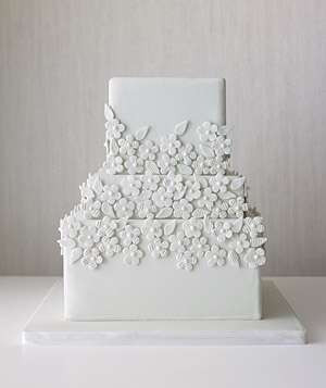 Tiered wedding cake decorated with monochromatic flowers12 Great Wedding Cakes   Real Simple. Real Simple Wedding Cakes. Home Design Ideas