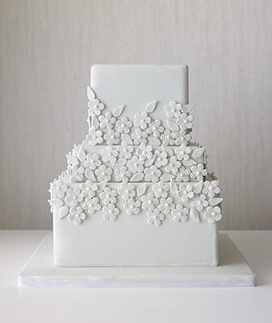 12 great wedding cakes real simple tiered wedding cake decorated with monochromatic flowers junglespirit Choice Image