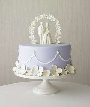 Purple cake with bride and groom topperHow to Save Money on Your Wedding   Real Simple. Real Simple Wedding Cakes. Home Design Ideas