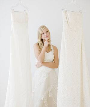 Young Woman Deciding Between Wedding Dresses Jamie