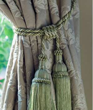 Curtain tied back with tassels