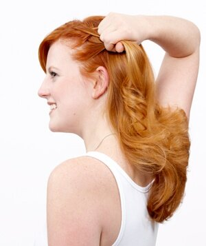 How to do a side french braid bun real simple step 1 of the side french braid bun ccuart Images