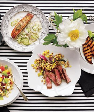 4 easy dinner party recipes real simple striped table with four plates and a flower forumfinder Gallery