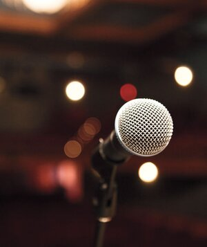 and now for an encore an essay about regret by adrienne starr  microphone in a dark theater