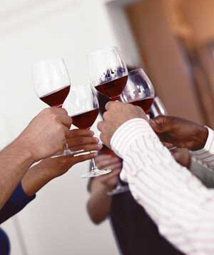 Host a wine tasting party real simple friends toasting one another solutioingenieria Images