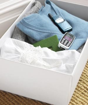 Box of sweaters and cell phones