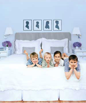 Children sitting on a bed