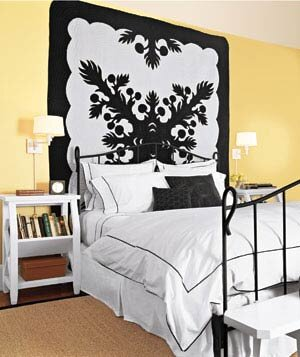 yellow bedroom with bold black and white graphic hanging quilt - Decorating Bedroom