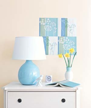 Blue lamp and artwork in a bedroom