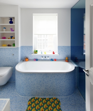 Kids' bathroom with blue mosaic tiles
