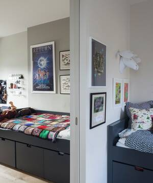 two bedrooms separated by pocket door beds have storage underneath - Shared Bedroom Ideas