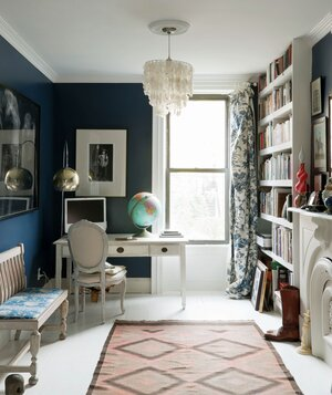 Navy blue walls in a home office