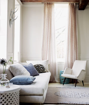 Beige room with light pink curtains