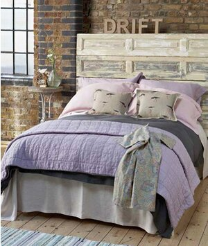 Pink and purple bedding and drift headboard