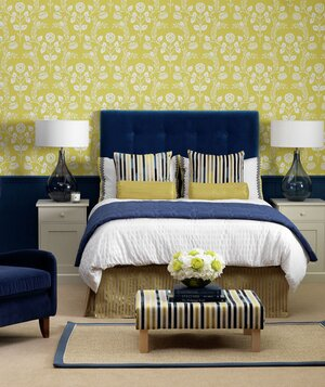 Navy and yellow accented bedroom