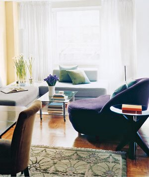 Living Room With Gray Modern Sofas And Big Purple Divan