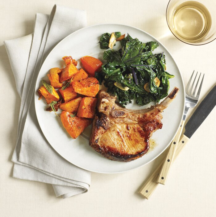 10 healthy kale recipes real simple roasted pork chops and butternut squash with kale one of our healthy dinner recipes forumfinder Choice Image