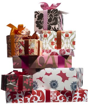 28 ideas for exchanging christmas gifts real simple stack of wrapped gifts negle Gallery