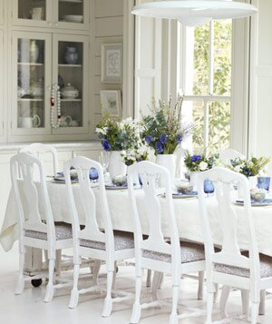 White Dining Room With High Backed Chairs And Gl Wood Cabinets