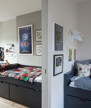 Two Bedrooms Separated By Pocket Door Beds Have Storage Underneath