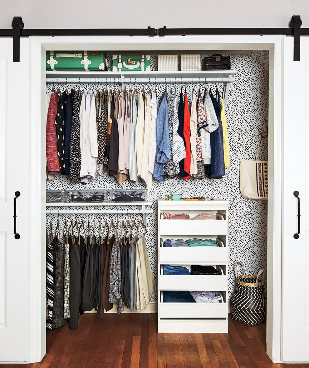 Organized Closet With Graphic Wallpaper