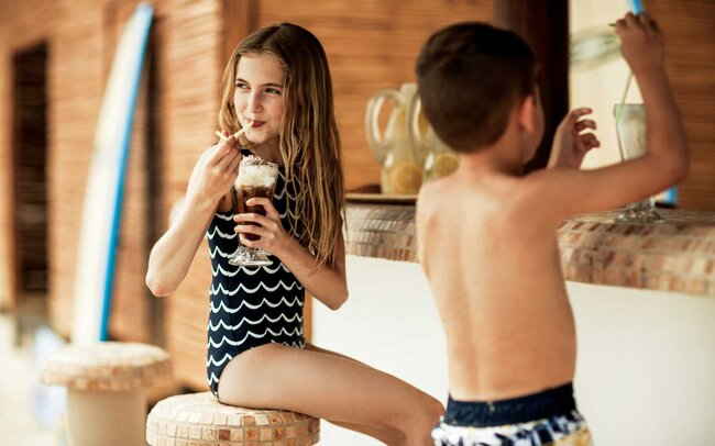 Kids enjoying ice cream at One & Only Resorts