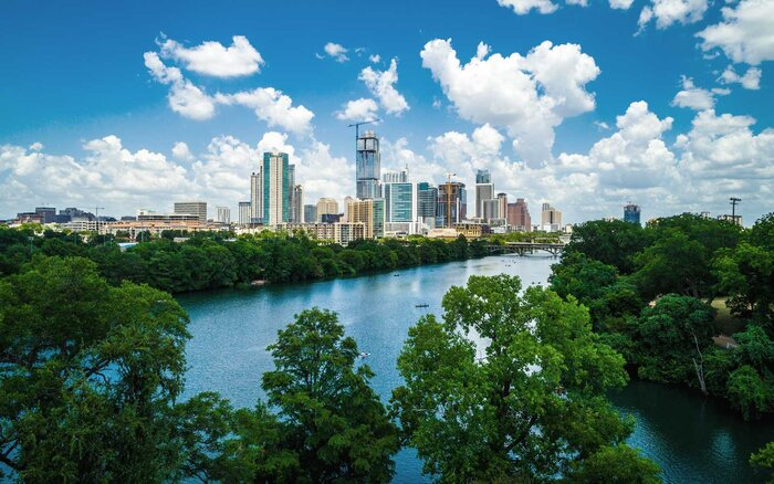 Gorgeous nature view above tree tops Austin Texas growing downtown skyline cityscape aerial drone view