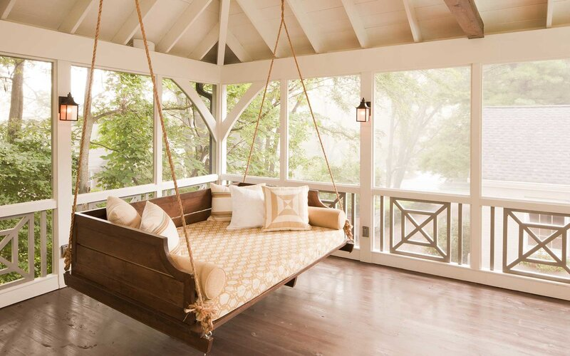 Large Comfortable Porch Swing in Screened Porch with Wooden Floor