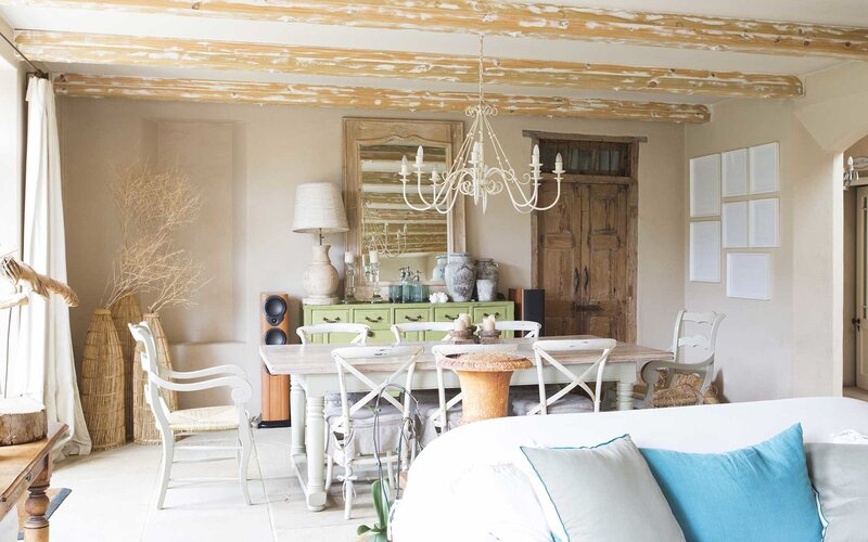 Living and dining area in rustic house