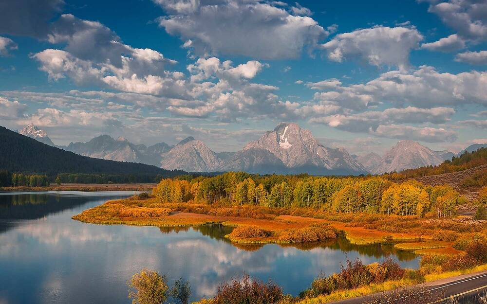 The Road Curves Around Stunning Oxbow Bend During Peak Of Autumn In Grand Teton