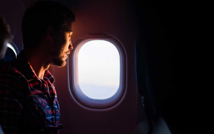 Image result for airplane window man