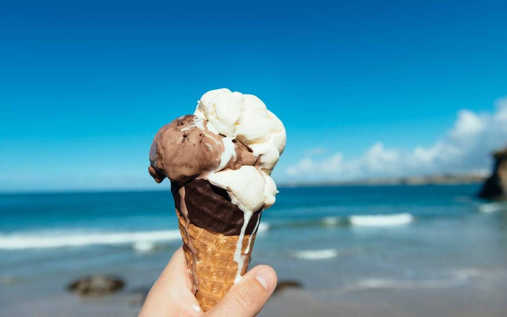 Eating ice cream at the beach in summer