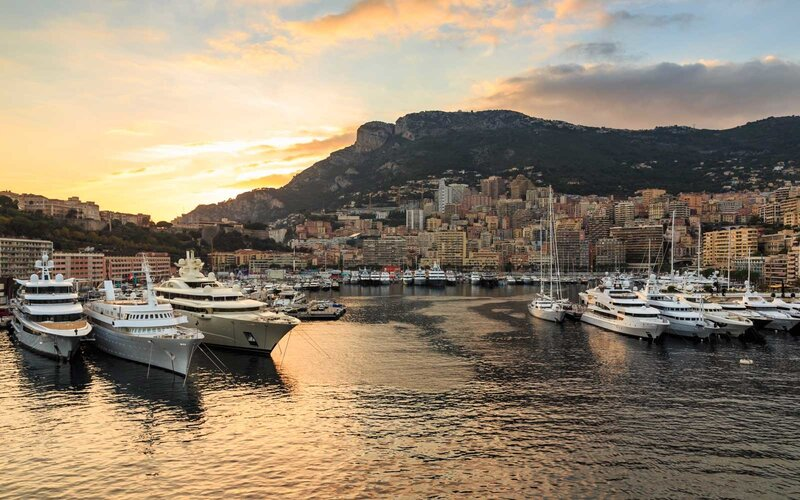 Vivid sunset over super yachts, glamorous harbour of Monaco