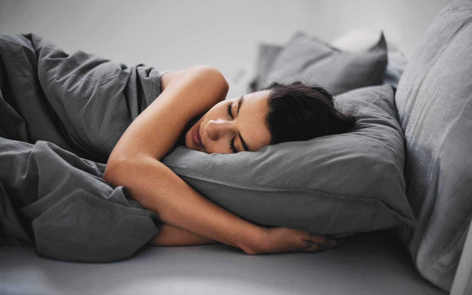 Girl Lying Down In Bed And Sleeping