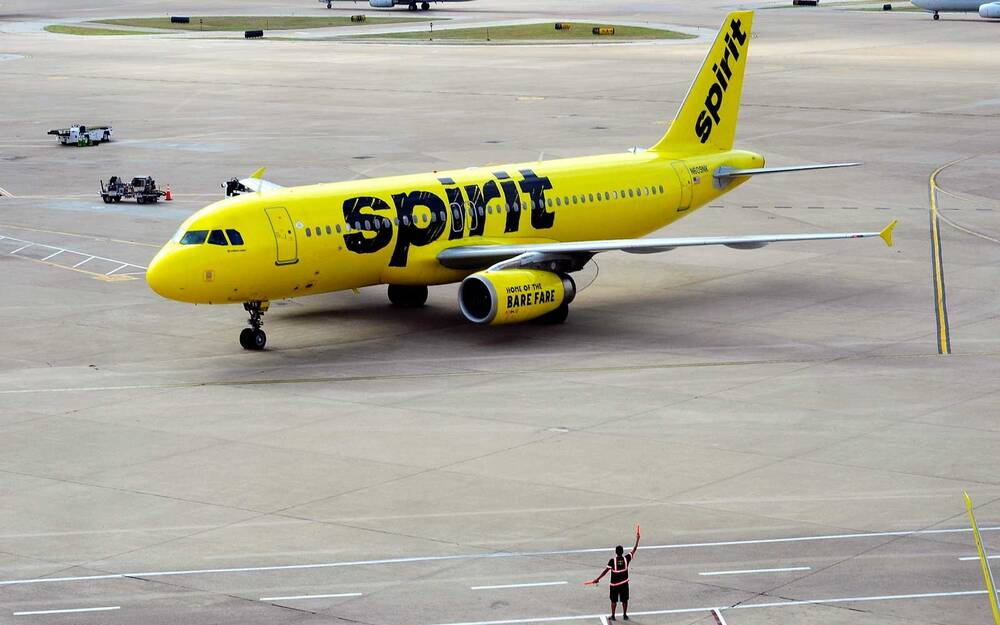 A Spirit Airlines Airbus A320 Passenger Jet Taxis At The Dallas Fort Worth International Airport