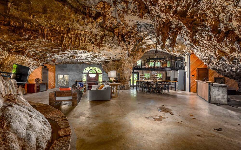 this luxury cave house is built into a mountain and you can rent