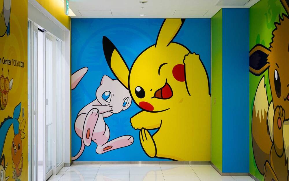 a mural of mew and pikachu two popular pokemon characters at the pokemon center
