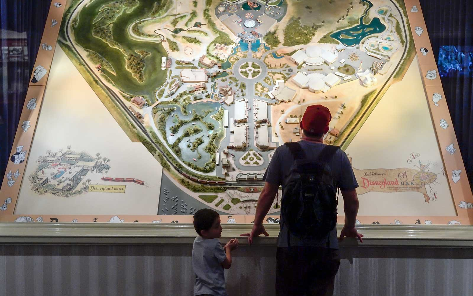 Visitors in the lobby of the Opera House on Main Street, U.S.A. check out a giant model of Disneyland