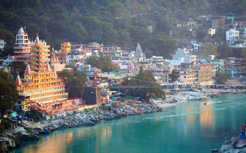 Spectacular view of the Lakshman Temple bathed by the sacred river Ganges at sunset