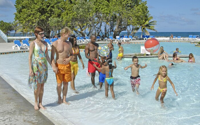 Family In Pool At Coconut Bay Beach Resort Spa St Lucia