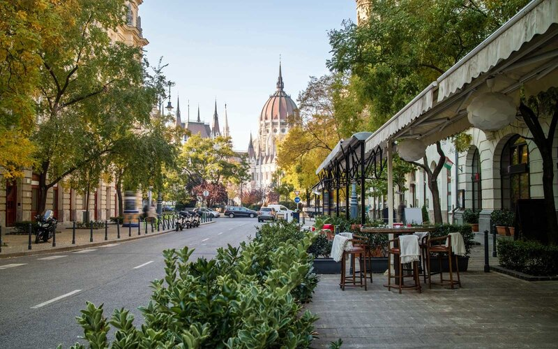 Street of Budapest with view at the Hungarian Parliament