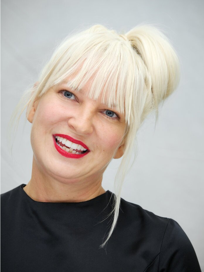 The 43-year old daughter of father Phil Colson and mother Loene Furler Sia in 2019 photo. Sia earned a  million dollar salary - leaving the net worth at  million in 2019